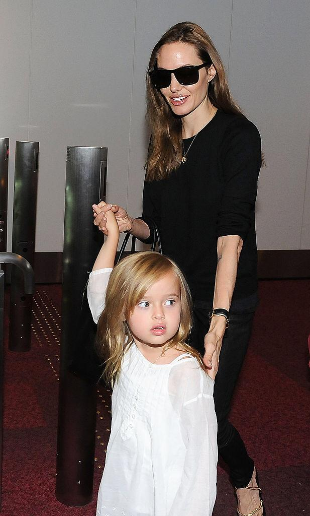 Angelina Jolie and Vivienne Jolie-Pitt arrive at Tokyo International Airport on July 28, 2013 in Tokyo, Japan | Photo: Getty Images