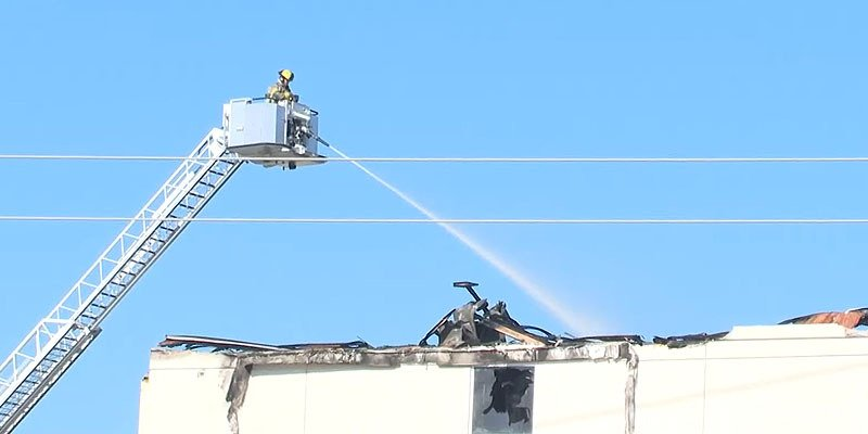 The Killeen Fire Department was still spraying the top floor of the Hilton Garden Inn, in Killeen, Texas, the morning after the fire broke out   Photo: KCENNews