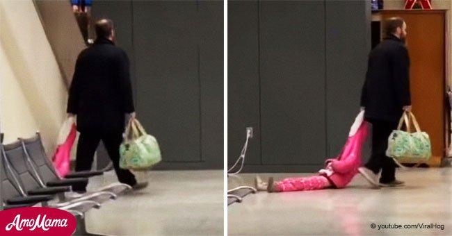 Niña agotada se negó a caminar, así que su papá la arrastra por el aeropuerto en hilarante video