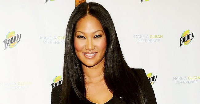 Kimora Lee Simmons' Daughter Aoki Looks Cute Holding a Rose in Her Hand in a Floral-Print Top