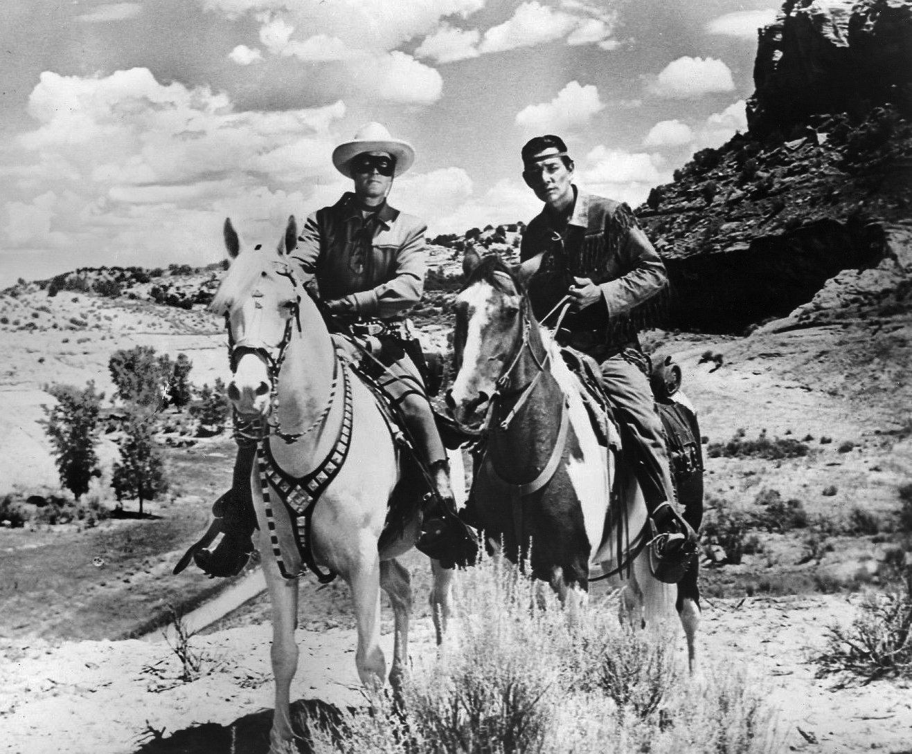"""Clayton Moore as the """"Lone Ranger"""" and Jay Silverheels as Tonto in 1956.   Source: Wikimedia Commons."""