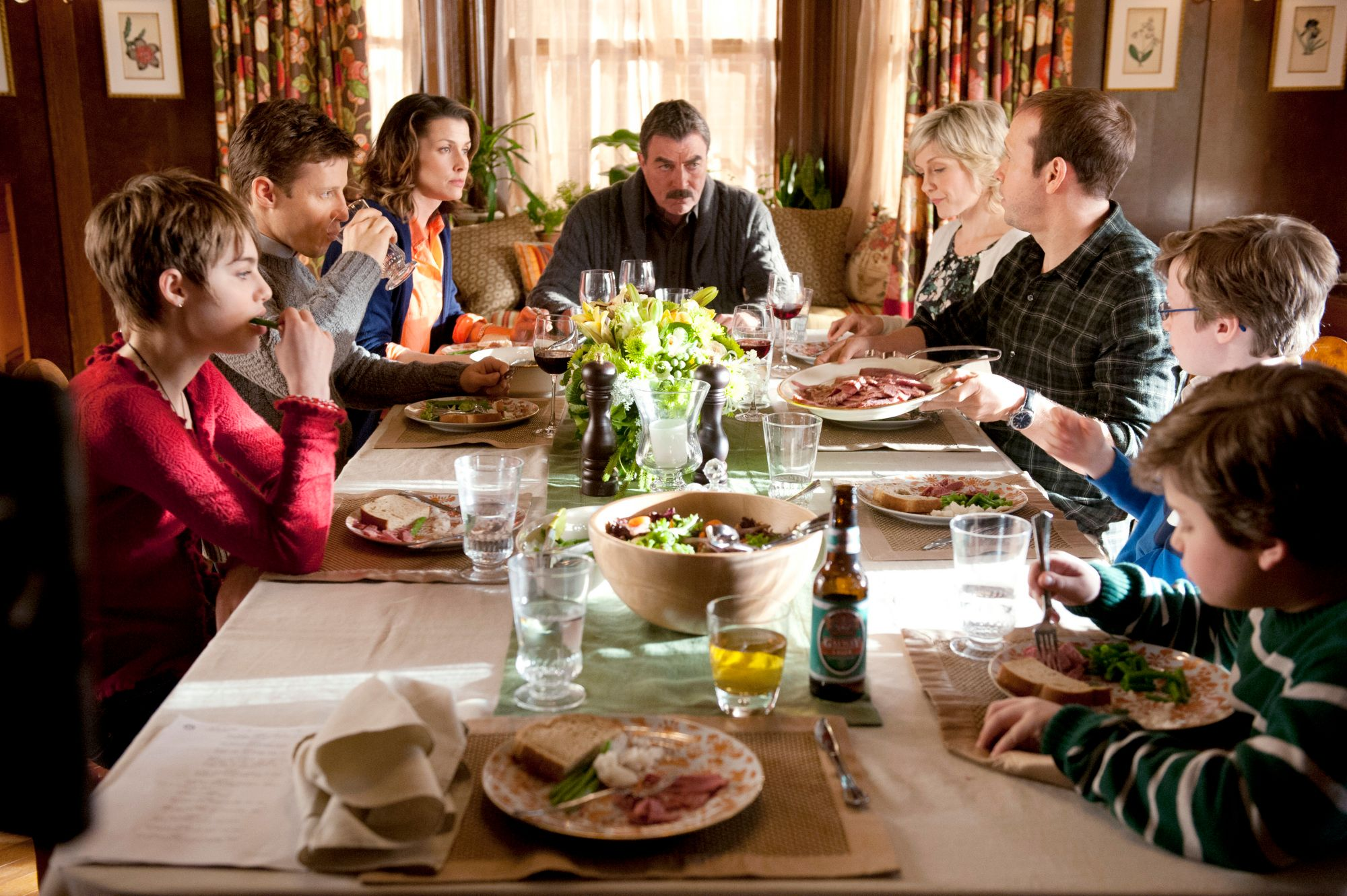 """The show's cast: Nicky (Sami Gayle), Jamie (Will Estes), Erin (Bridget Moynahan), Frank (Tom Selleck), Linda (Amy Carlson), Danny (Donnie Wahlberg), Jack (Tony Terraciano) and Sean (Andrew Terraciano) during family dinner, on """"Blue Bloods,"""" Friday, March 9. 