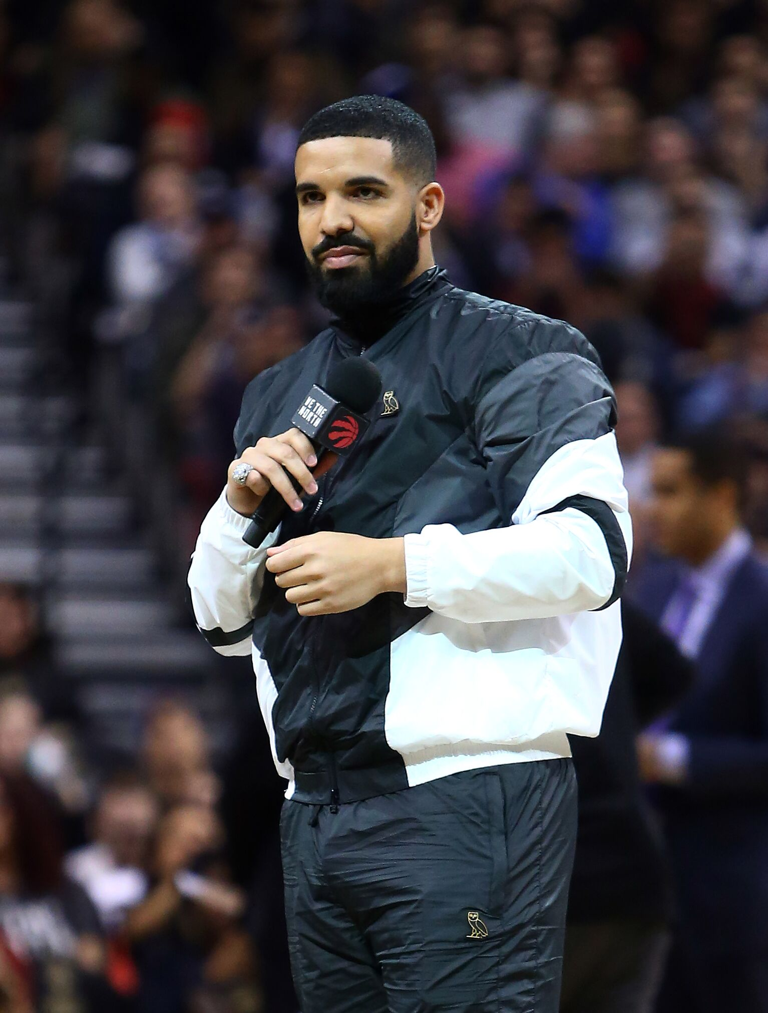 Drake, Toronto Raptors Ambassador, speaks to the crowd on 'Drake Night' during the first half of an NBA game | Getty Images