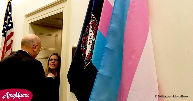 Rep. Jennifer Wexton hangs a Transgender Pride Flag outside her Capitol Hill Office