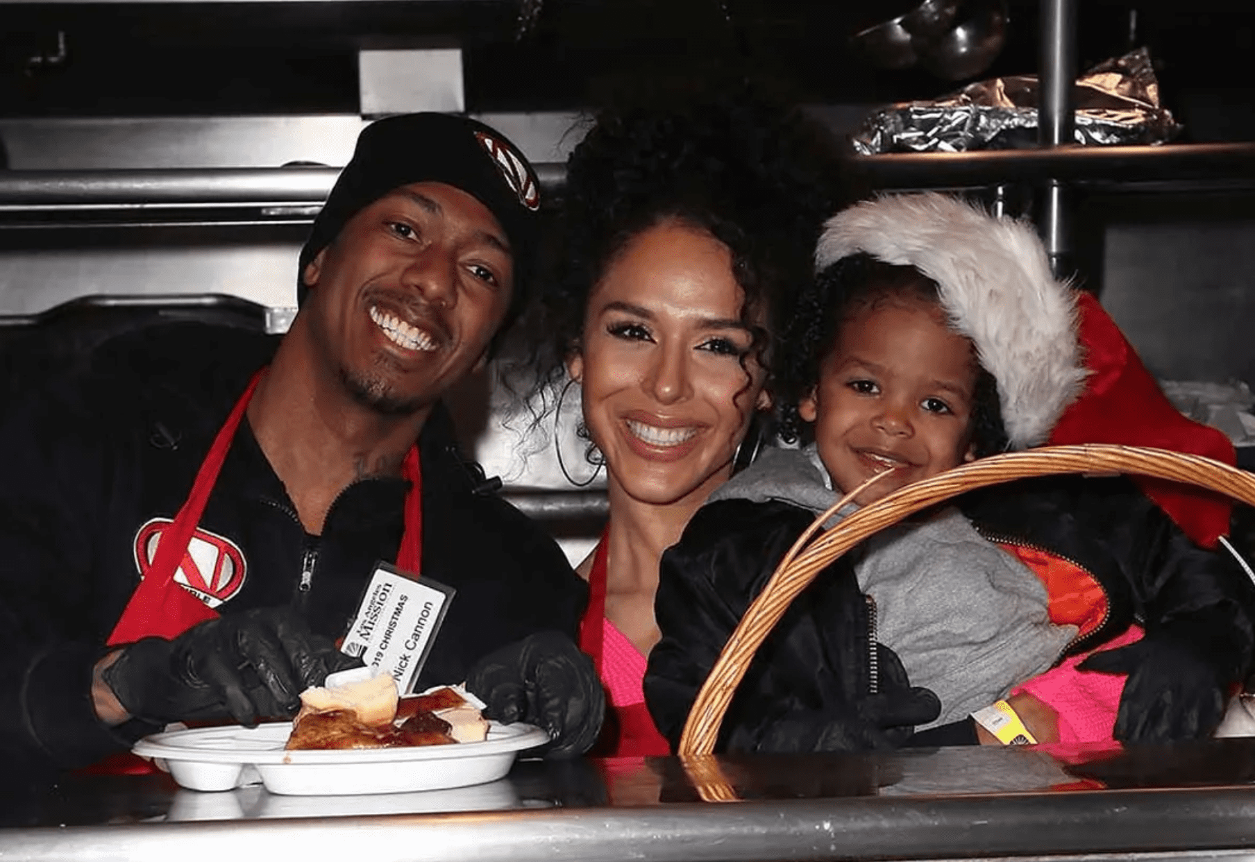 """Nick Cannon and Brittany Bell with their son Golden Cannon attending the """"Christmas Celebration on Skid Row"""" at the Los Angeles Mission in December 2019. 