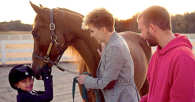 Savannah and Chase Chrisley Smile with Niece Chloé in a Photo with a Horse