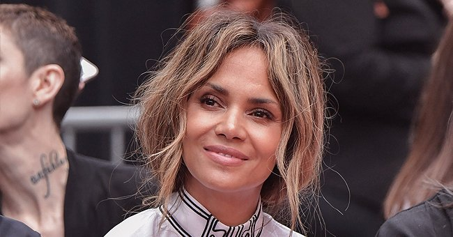 Halle Berry Draws Attention to Her Slim Waist as She Poses in a Black Top & Leggings (Photo)