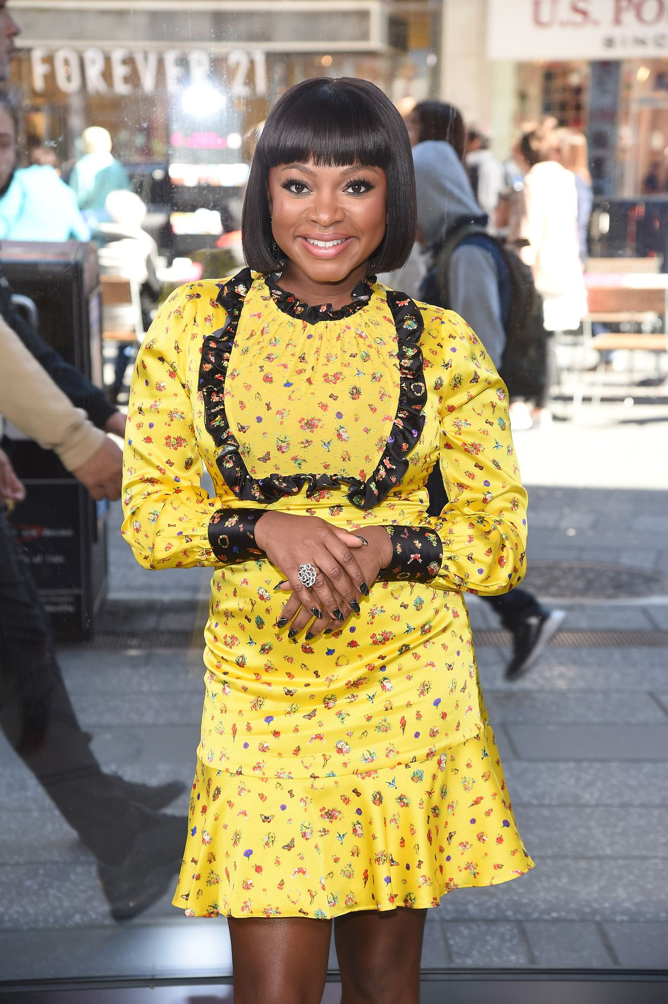 """Naturi Naughton visiting """"Extra"""" at the Levi's store in Times Square on October 10, 2019 in New York City. 
