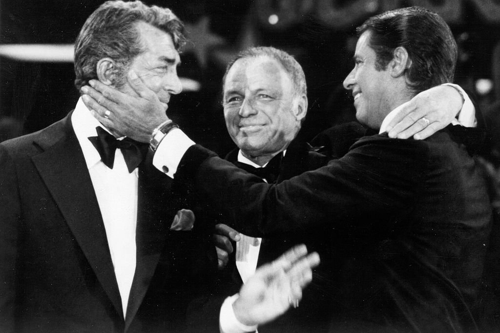 Singers Dean Martin, Frank Sinatra and Jerry Lewis perform during the 1976 telecast of The Jerry Lewis MDA Telethon in Los Angeles, California.   Source: Getty Images