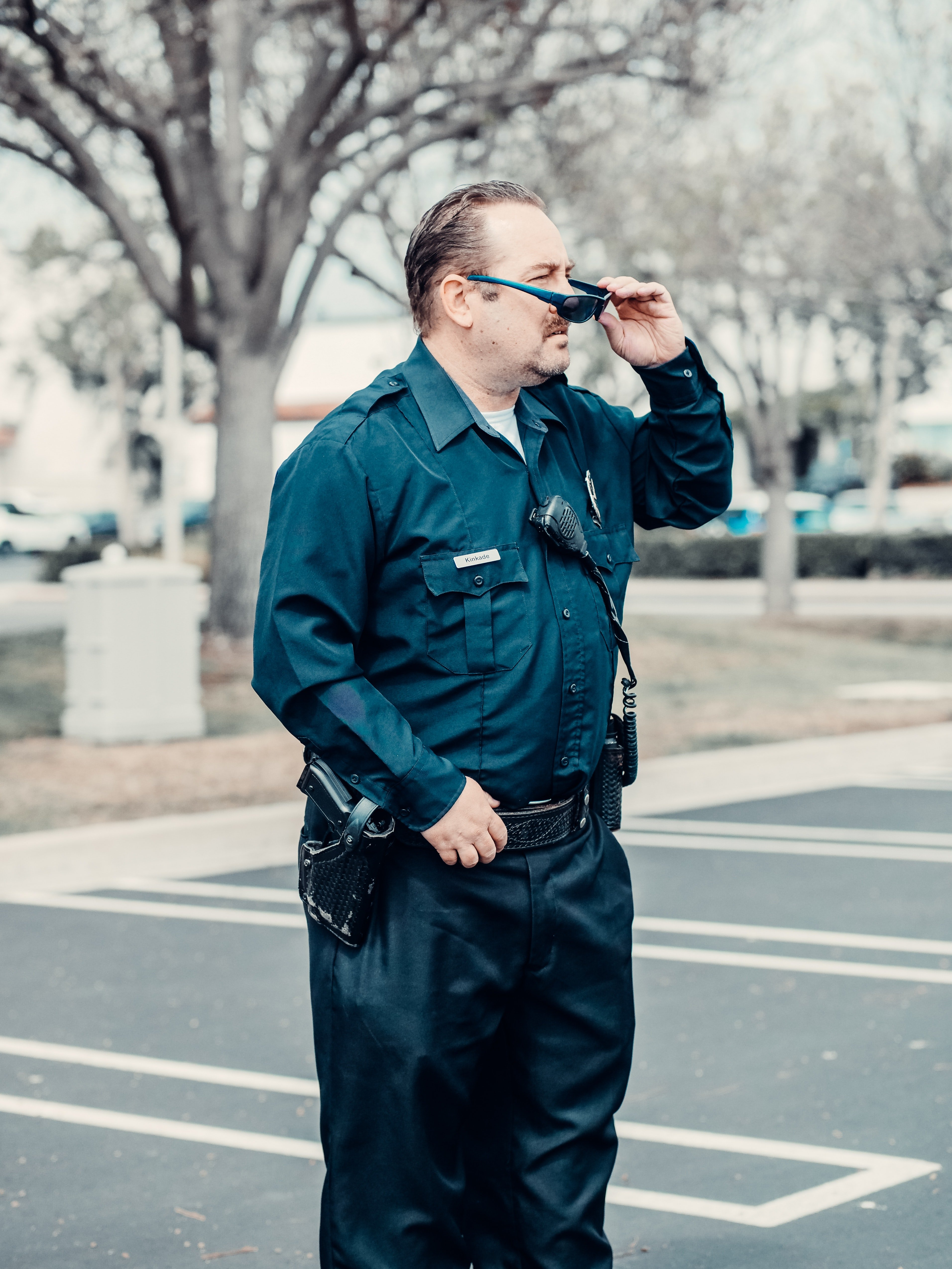 An officer in blue uniform standing on the road.   Photo: Pexels/Kindle Media