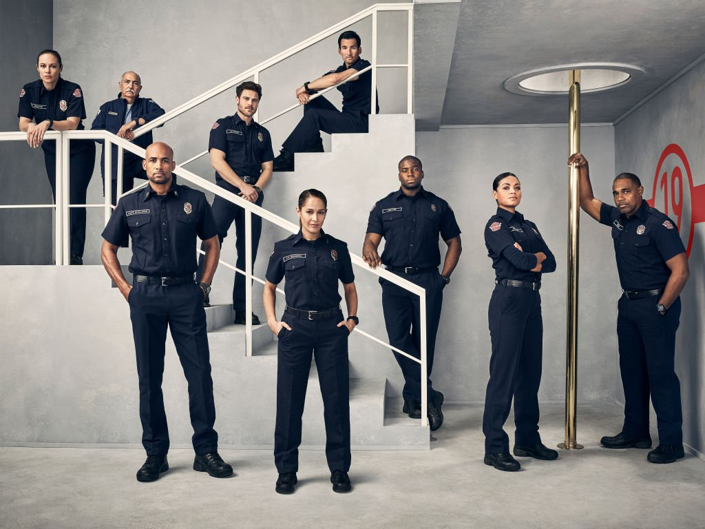 "The cast for ABC's ""Station 19"" pose for a promotional photo in a fire station on November 17, 2019