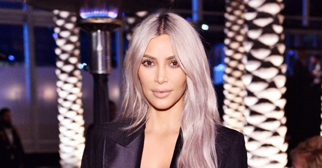 Kim Kardashian Earns Fans' Approval Wearing Sexy Red and Black Striped Gown with Deep Cleavage in Throwback Pic