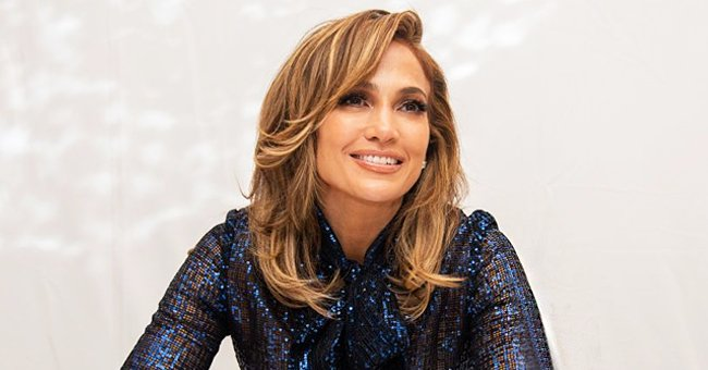 J-Lo, 51, Ditches Pants in Bed & Flaunts Her Endless Legs in Chic Patent Leather Boots