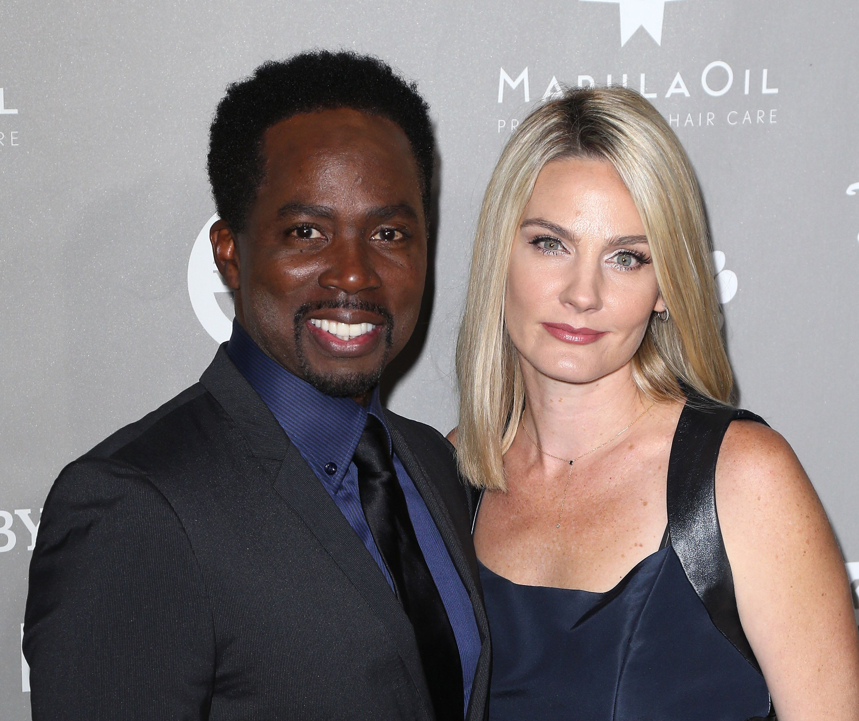 Actor Harold Perrineau (L) and wife Brittany Perrineau attend the 2015 Baby2Baby Gala presented by MarulaOil & Kayne Capital Advisors Foundation at 3LABS on November 14, 2015 in Culver City, California. | Photo: Getty Images.