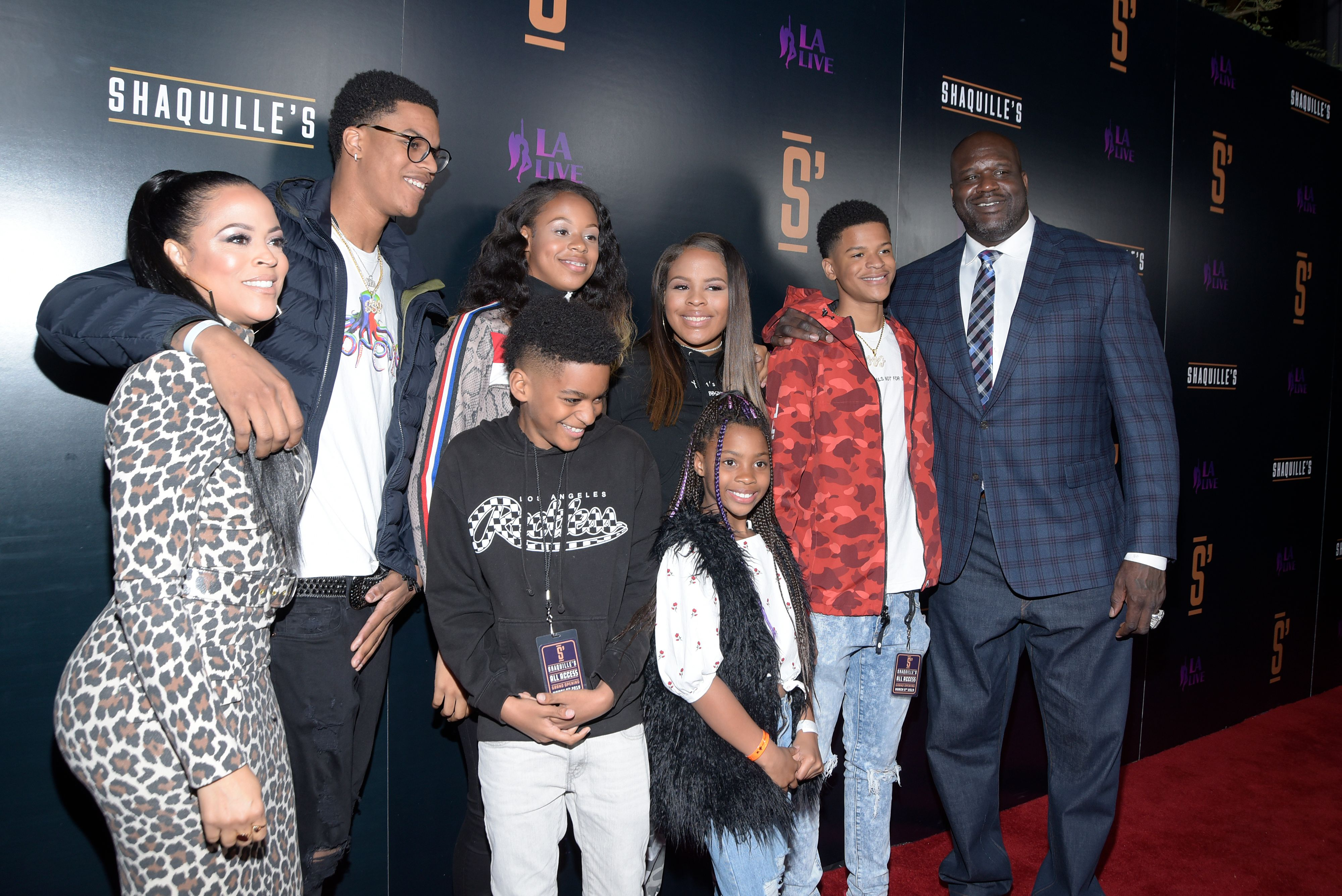 Shaunie O'Neal and Shaquille O'Neal and their family pose on the red carpet at the opening of Shaquille's At L.A. Live on March 09, 2019, in Los Angeles, California | Source: Michael Tullberg/Getty Images