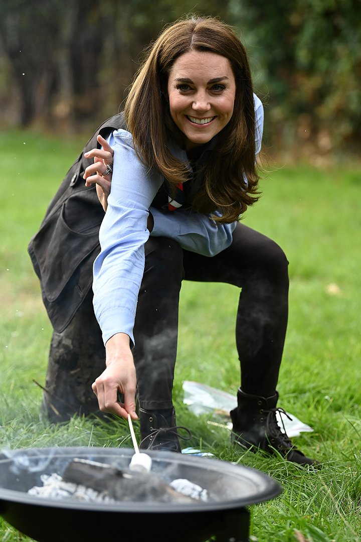 Kate Middleton toasting marshmallows during her visit to a Scout Group in Northolt, northwest London in September 2020. I Image: Getty Images.
