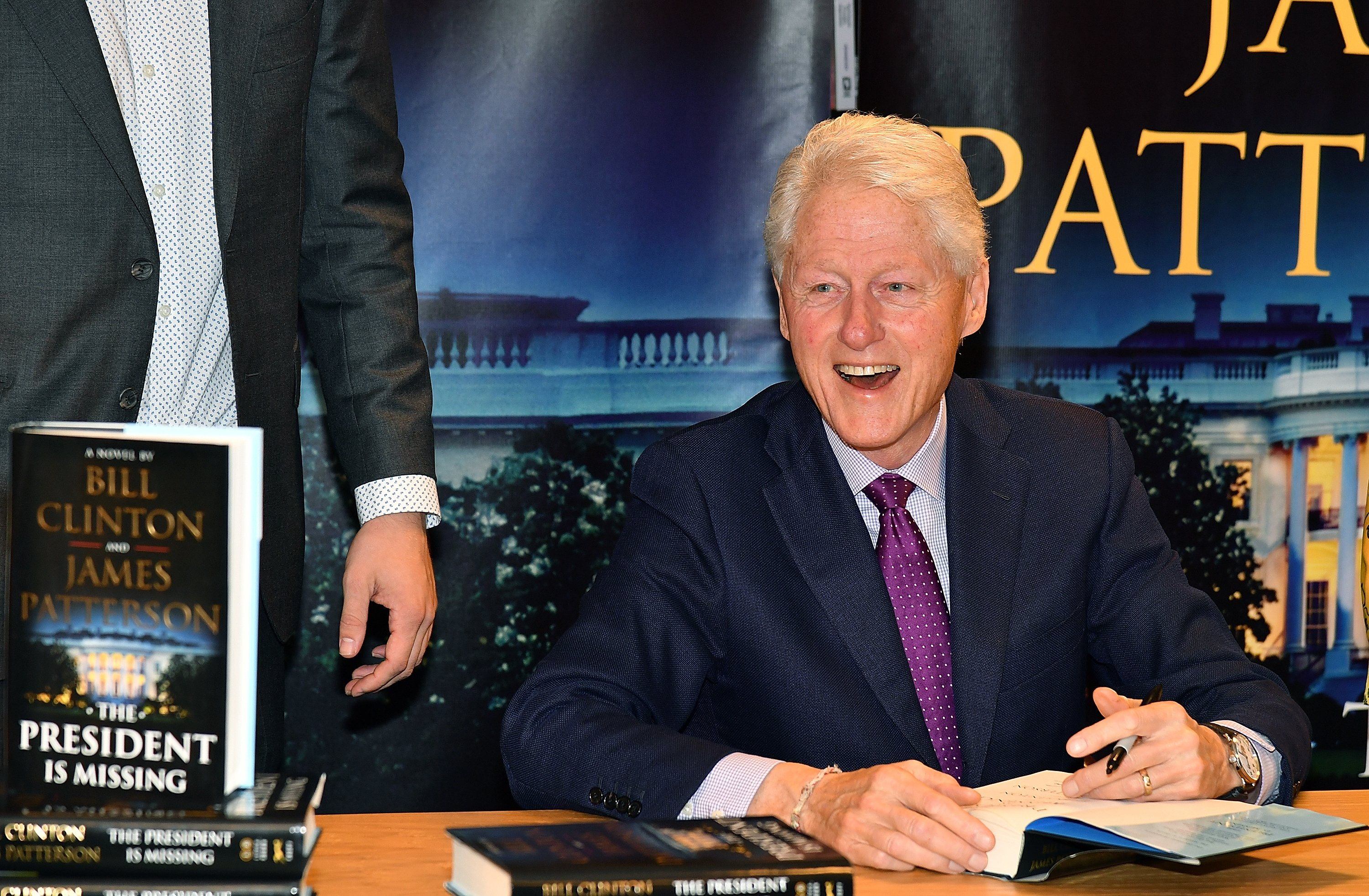 """Bill Clinton signs copies of his new book co-authored with James Patterson """"The President Is Missing"""" at Barnes & Noble on June 5, 2018 in New York City 