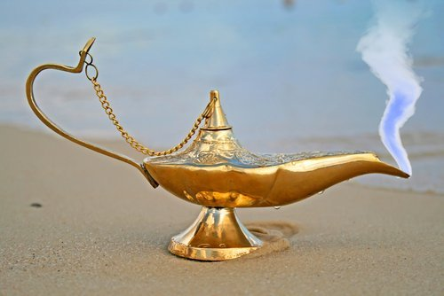 A genie lamp on the shore. | Source: Shutterstock.