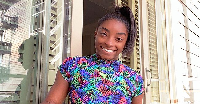 Simone Biles Poses in a Floral Swimsuit Showing Her Stunning Abs & Belly Piercing (Photos)