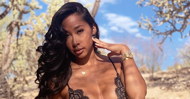 Omarion's Ex Apryl Jones Catches Fans' Attention Posing for a Snap in a Lacy Top & Ripped Jeans