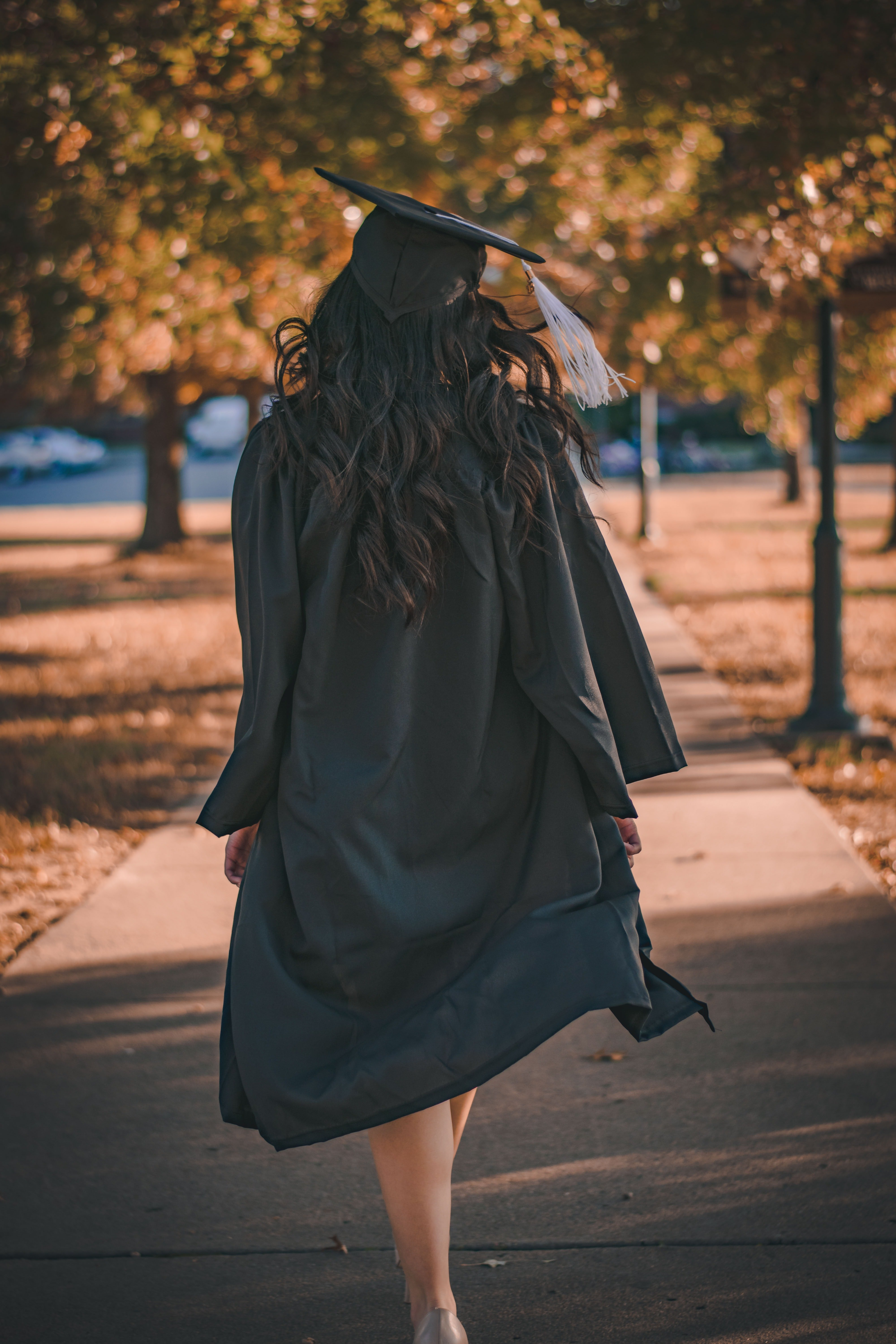 A woman walks away after her graduation ceremony | Source: Pexels