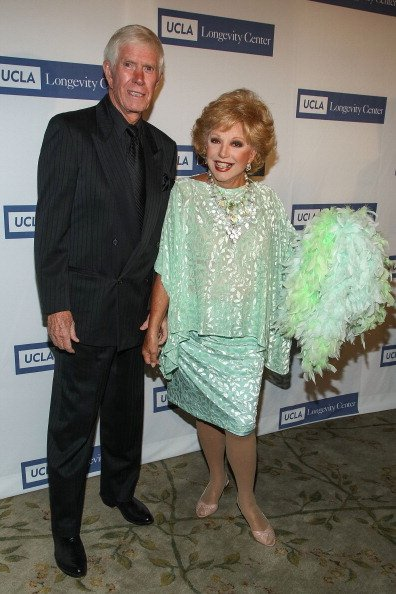 Webster B. Lowe Jr. and Ruta Lee at Beverly Hills Hotel on May 21, 2013 in Beverly Hills, California. | Photo: Getty Images
