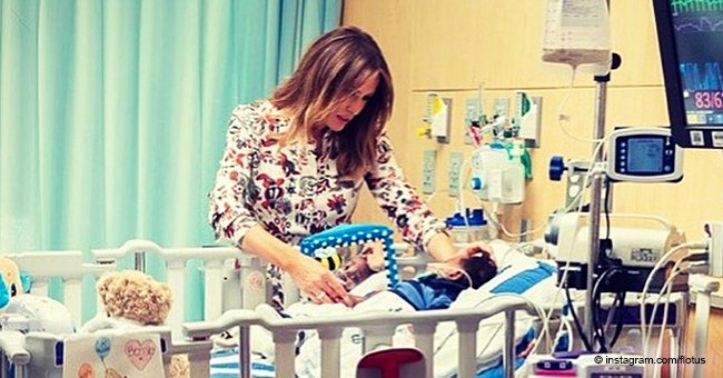 Melania Trump just shared new photos from a children's hospital giving high fives to sick kids