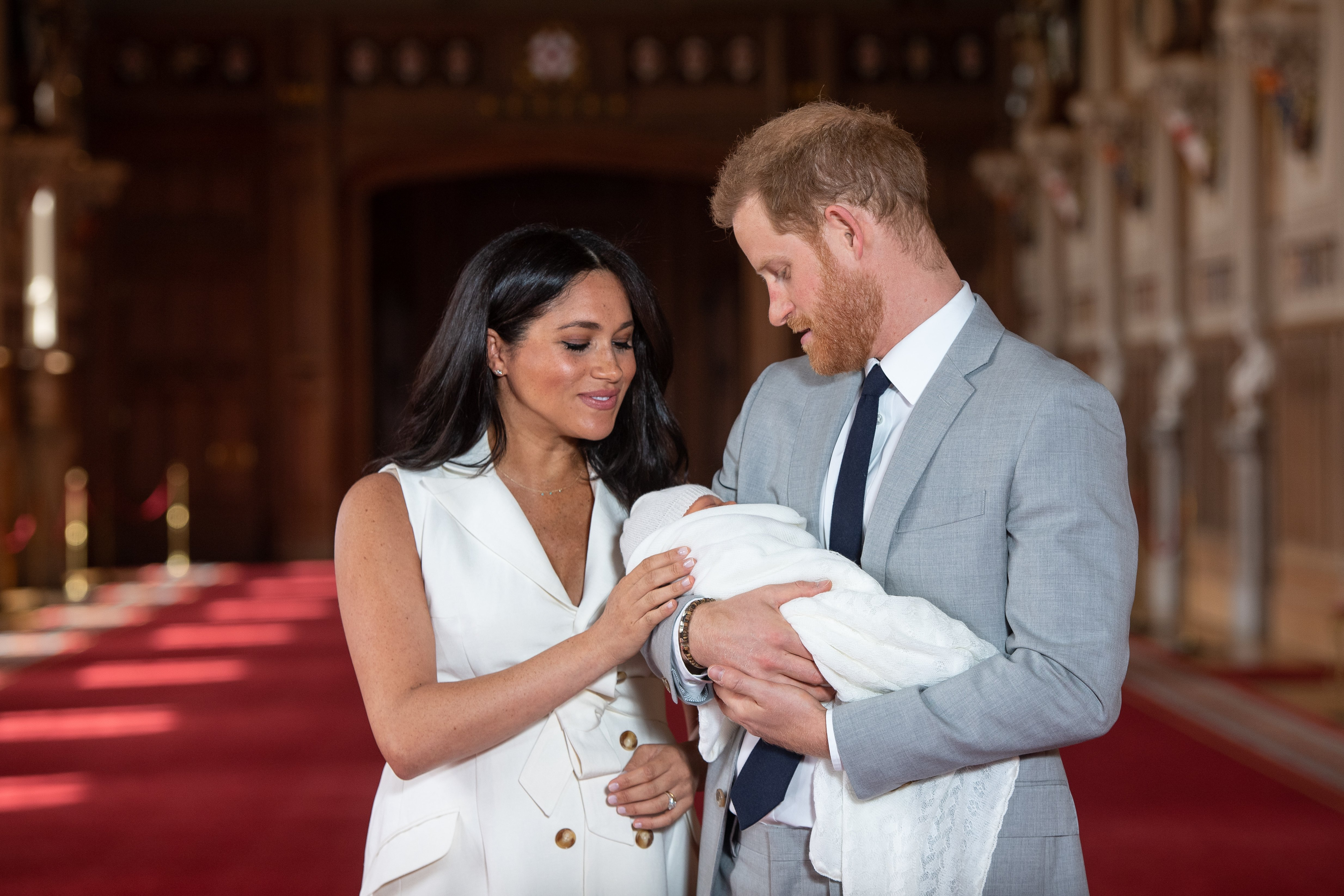 Prince Harry and Meghan Markle with their son Archie in St George's Hall at Windsor Castle on May 8, 2019, in Windsor, England. | Source: Getty Images.
