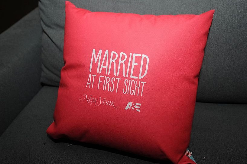 A promotional pillow advertising reality show Married At First Sight.  Source | Photo: Getty Image