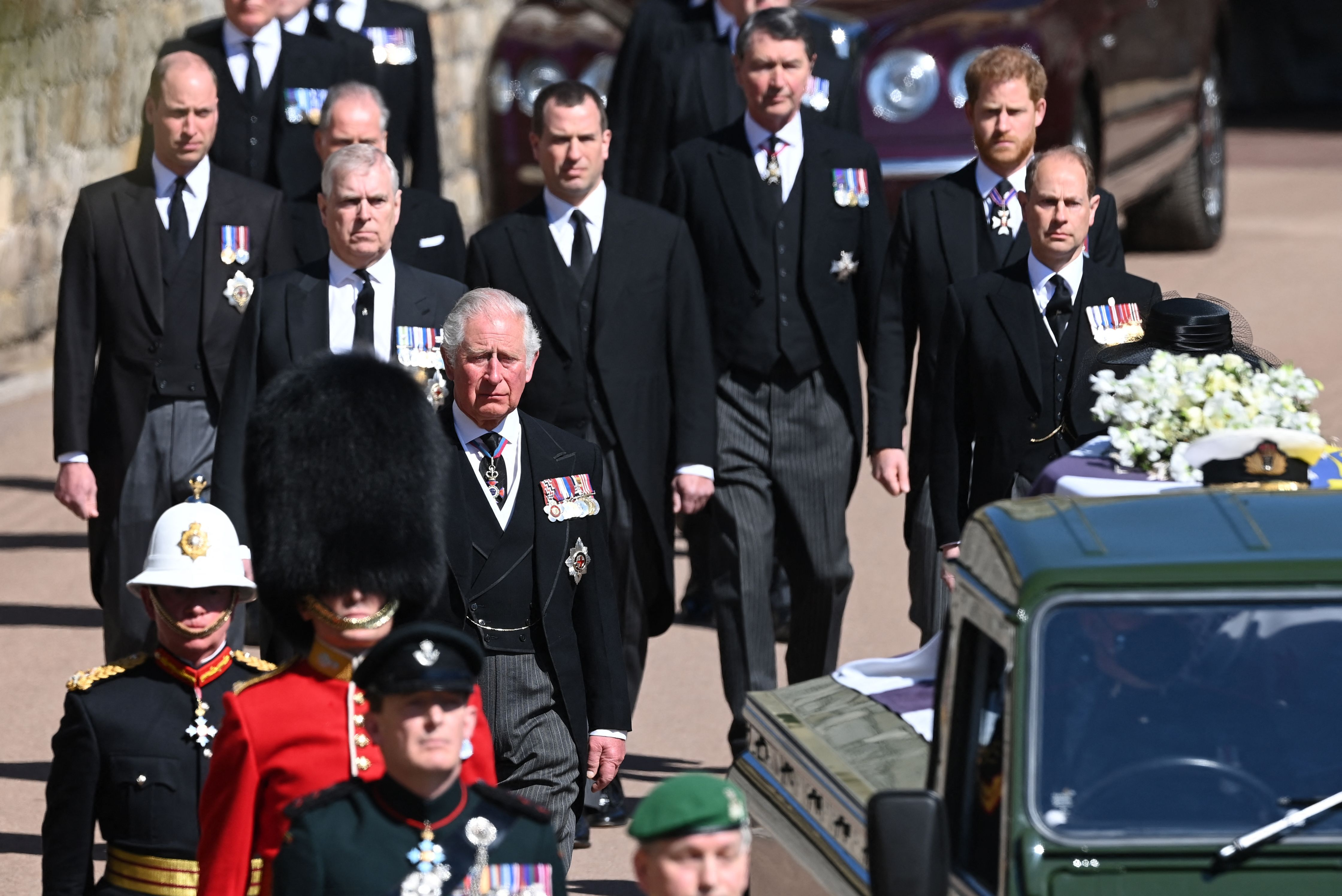 Charles, Prince of Wales and his sons Prince William and Prince Harry walk during the ceremonial funeral procession of Prince Philip on April 17, 2021 | Photo: Getty Images
