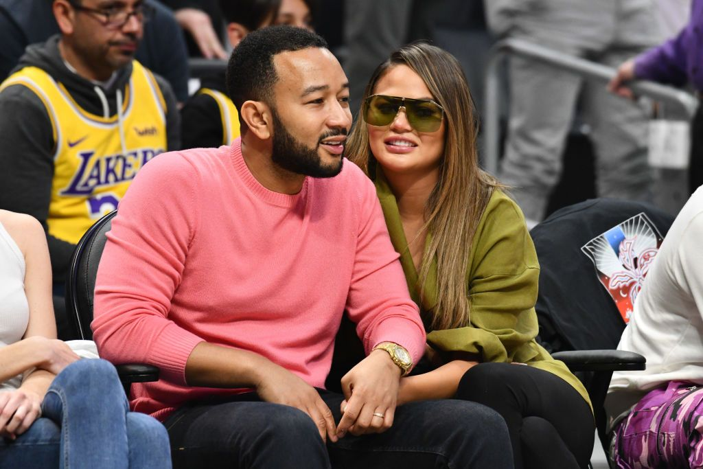 John Legend and Chrissy Teigen at a basketball game between the Los Angeles Clippers and the Los Angeles Lakers in March 2020 in Los Angeles | Source: Getty Images