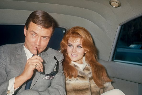 Roger Smith with sun glasses and Ann-Margret in the back of a limo; circa 1970 | Photo: Getty Images