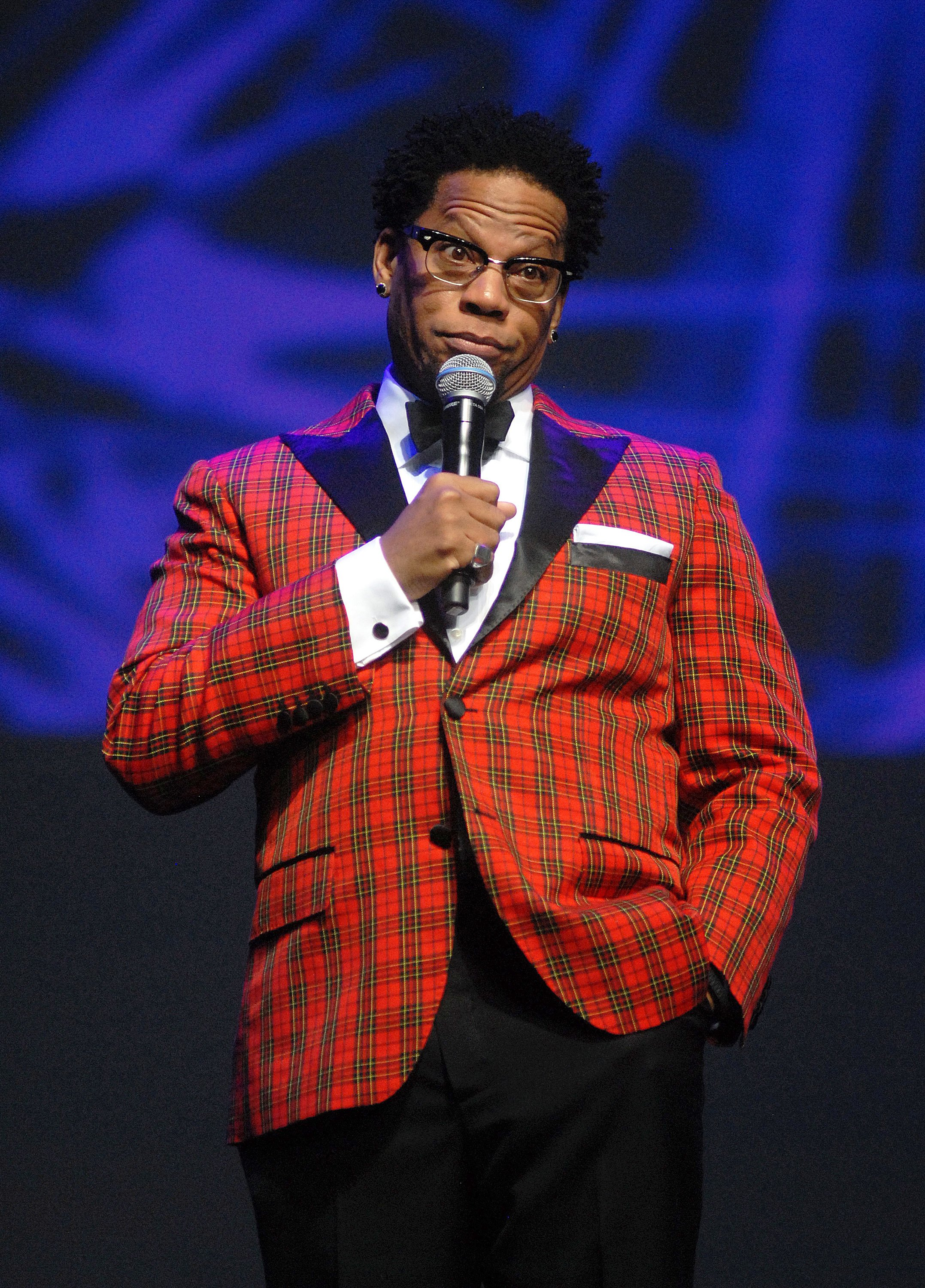 D.L. Hughley performs at MotorCity Casino's Sound Board Theater in 2014 in Detroit | Source: Getty Images