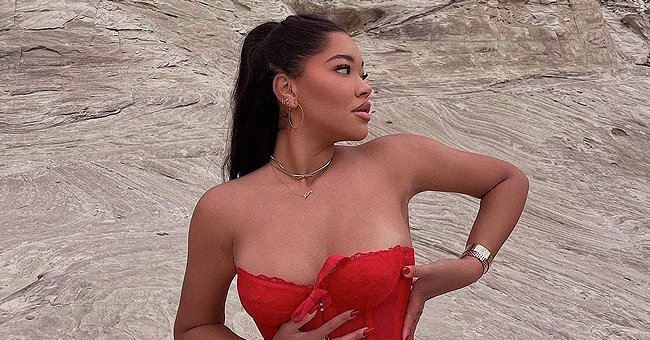 Kimora Lee Simmons' Daughter Ming Pours Her Curves into Skinny Jeans and a Red Strapless Corset