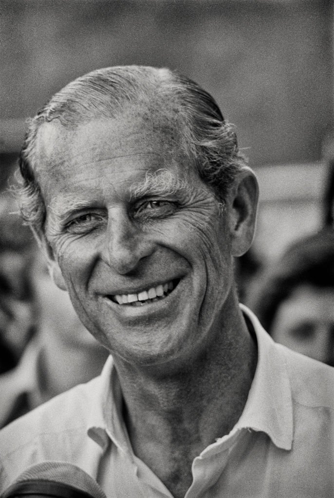 Prince Philip, Duke of Edinburgh smiles during a carriage driving event at Home Park, Windsor, England, July 1975   Photo: Getty Images