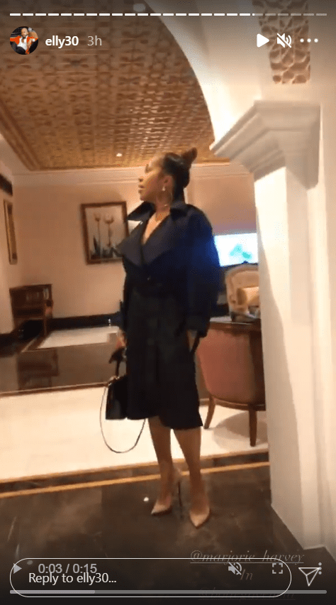 An image from a clip of Marjorie Harvey dressed in a black belted coat | Photo: Instagram/elly30