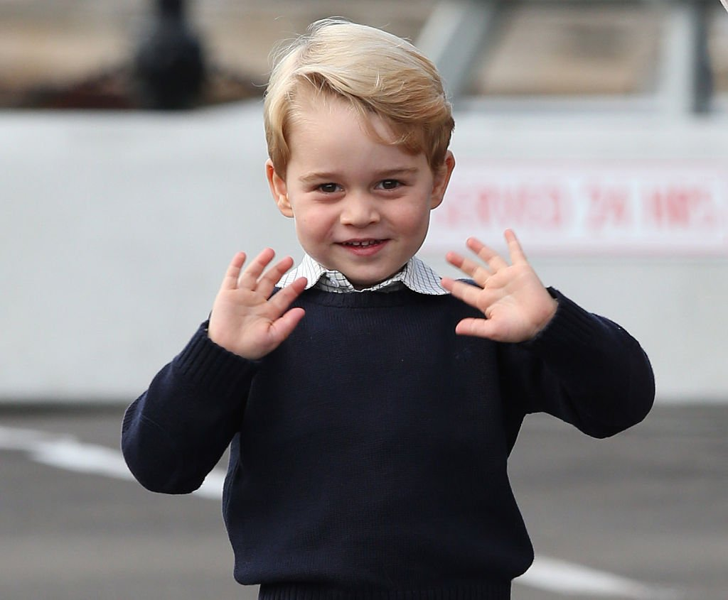 Prince George waves as he leaves from Victoria Harbour to board a sea-plane on the final day of their Royal Tour of Canada on October 1, 2016 | Photo: Getty Images