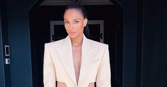 Ciara Catwalks in a Cream Suit with Sheer Panels Displaying Her Cleavage in a New Video