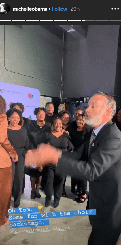 Michelle Obama and Tom Hanks have fun with a choir backstage at the Elizabeth Dole Foundation's Hidden Heroes gala | Source: instagram.com/michelleobama