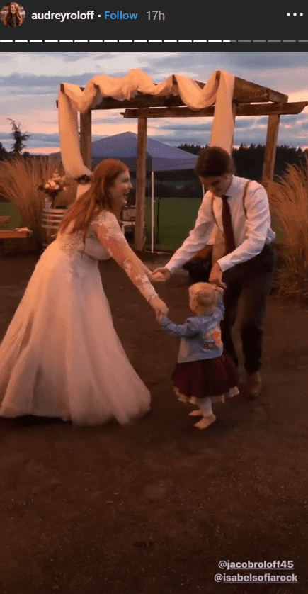 Jacob Roloff and Isabel Rock dancing with Ember Roloff on their wedding day | Photo: instagram.com/audreyroloff