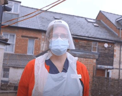Dr. Anne Hampton dressed up in PPE during her visit to The Steppe care home.   Source: YouTube/SWNS.