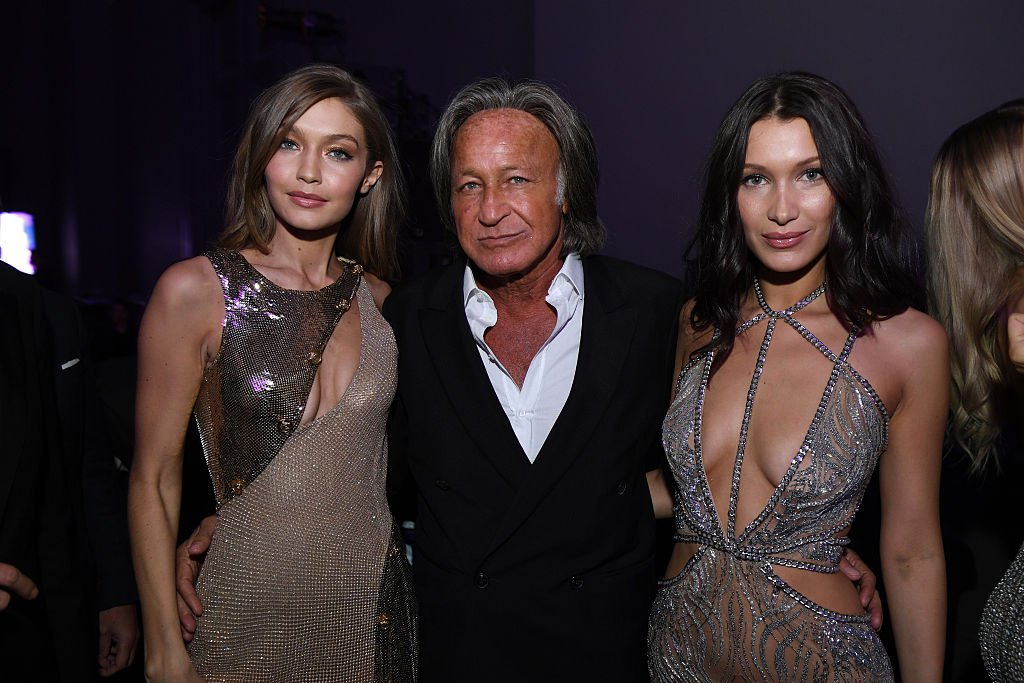 Gigi Hadid, Mohamed Hadid and Bella Hadid attend the Victoria's Secret After Party at the Grand Palais on November 30, 2016. | Photo: Getty Images