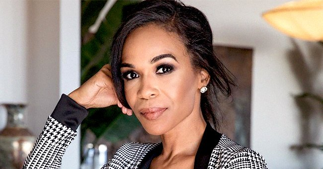 Michelle Williams Stuns with Her Voluminous Hair in Skintight Black Dress in New Year Photo
