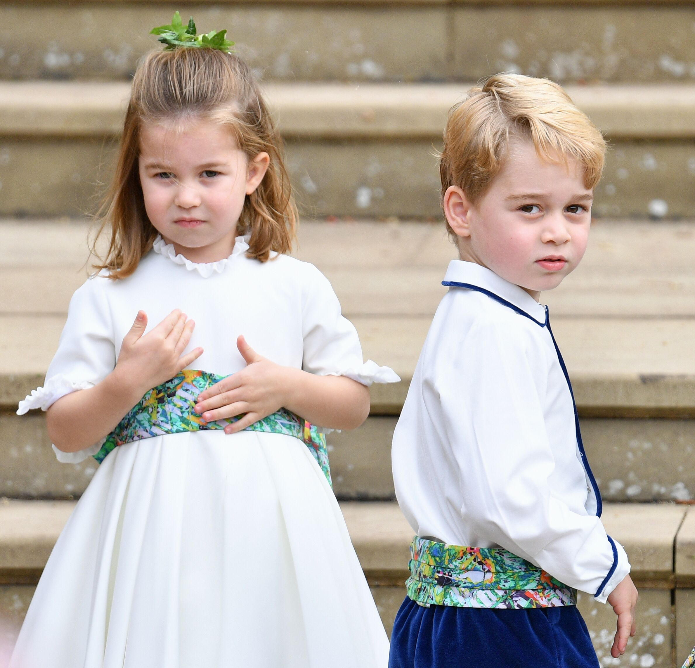 Princess Charlotte of Cambridge and Prince George of Cambridge attend the wedding of Princess Eugenie of York and Jack Brooksbank at St George's Chapel on October 12, 2018 in Windsor, England | Photo: Getty Images