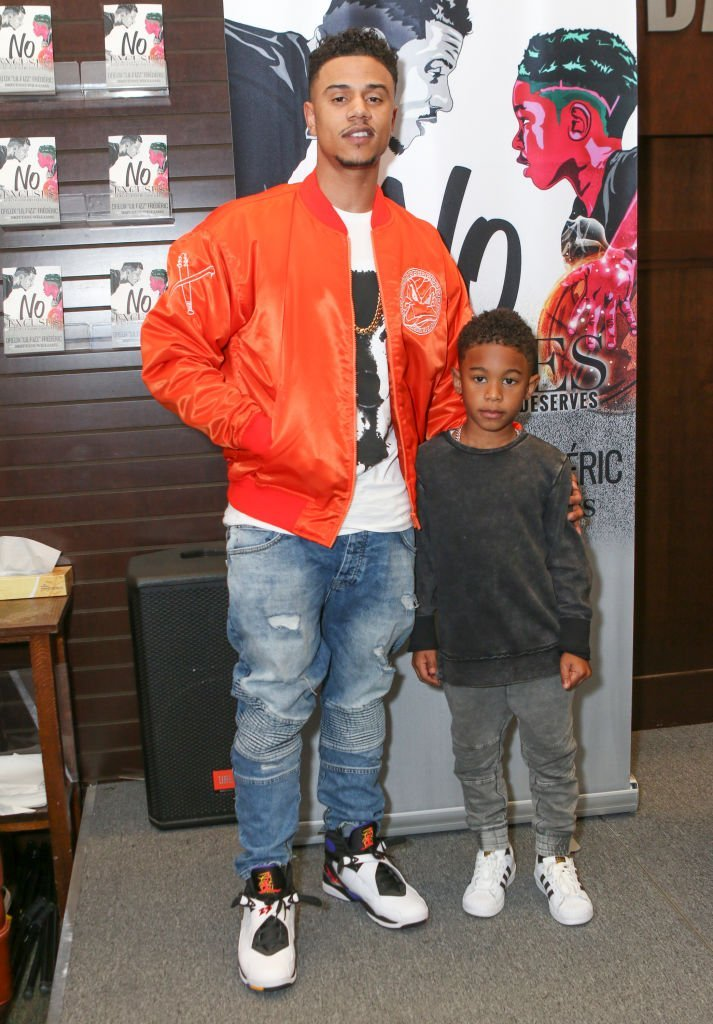 """Lil' Fizz (L) and son Kamron David Frederic attend the Hazel-E, Lil' Fizz and Brittani Williams book signing for """"Girl Code"""" and """"No Excuses"""" at Barnes & Noble at The Grove in Los Angeles, California 