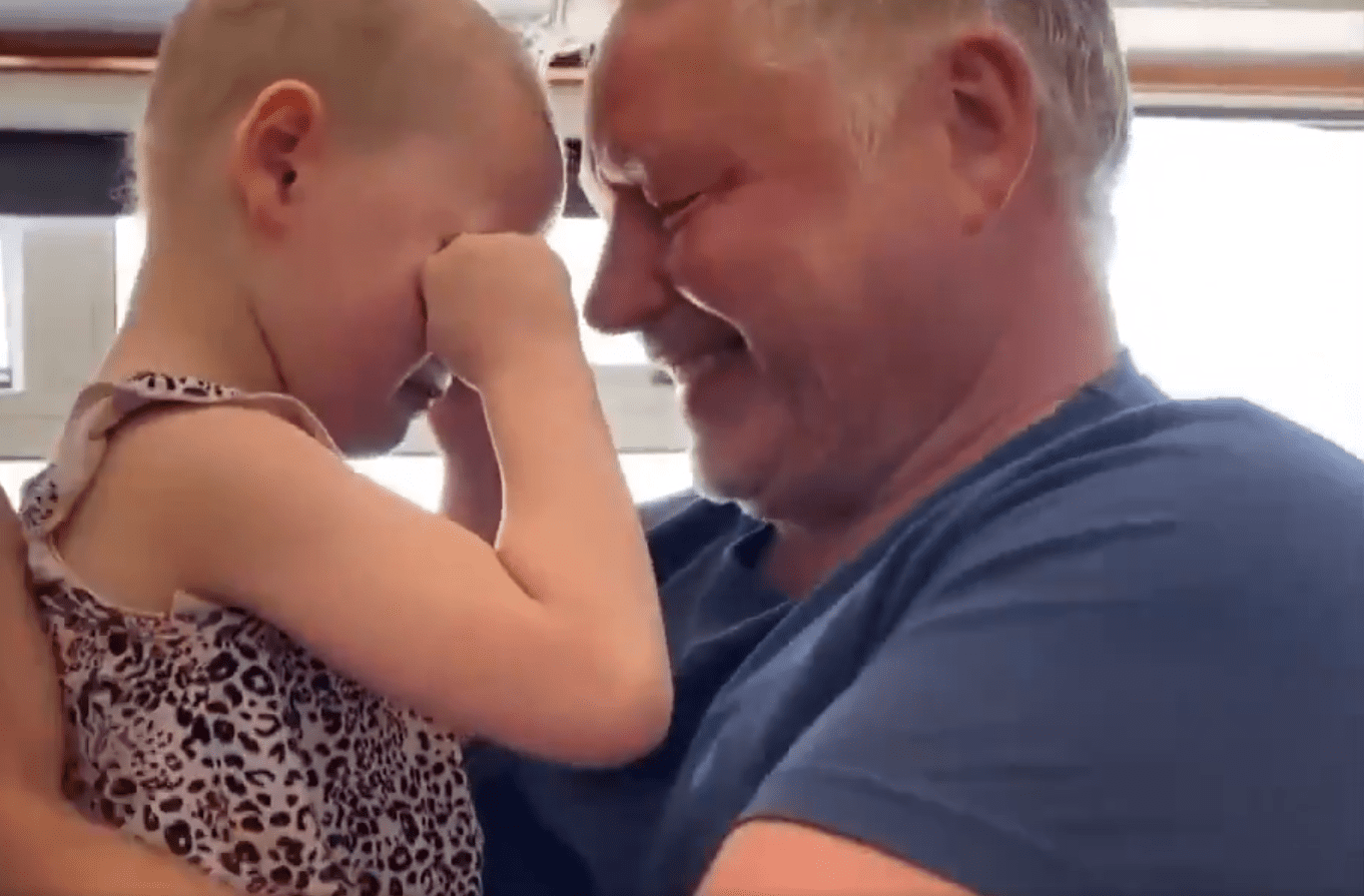 Mila Sneddon couldn't help but cry tears of joy recently when she finally got to hug her dad Scott for the first time in seven weeks. | Photo: Twitter/RexChapman