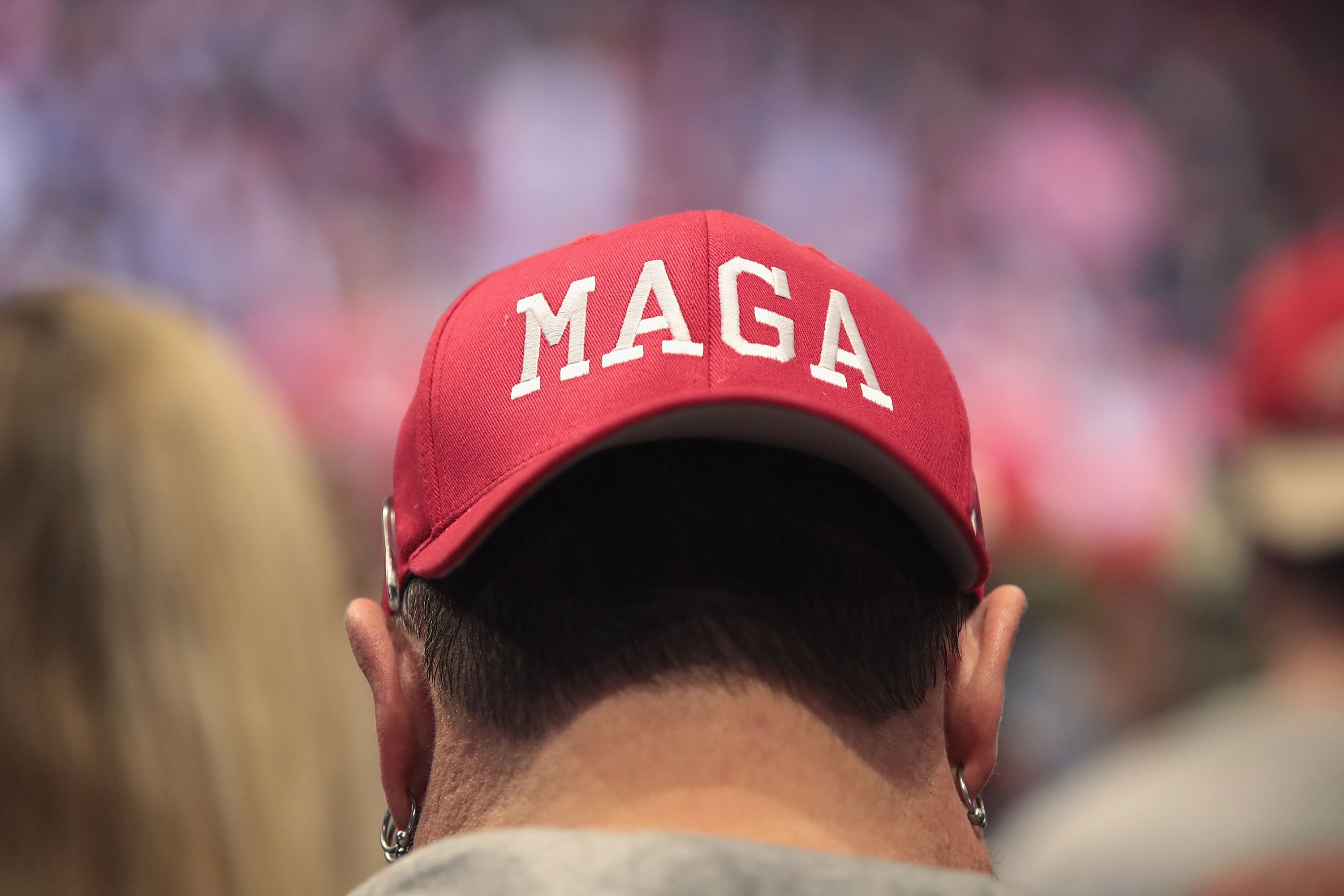A Donald Trump supporter wearing a MAGA hat during a rally at the Van Andel Arena in Grand Rapids, Michigan | Photo: Getty Images