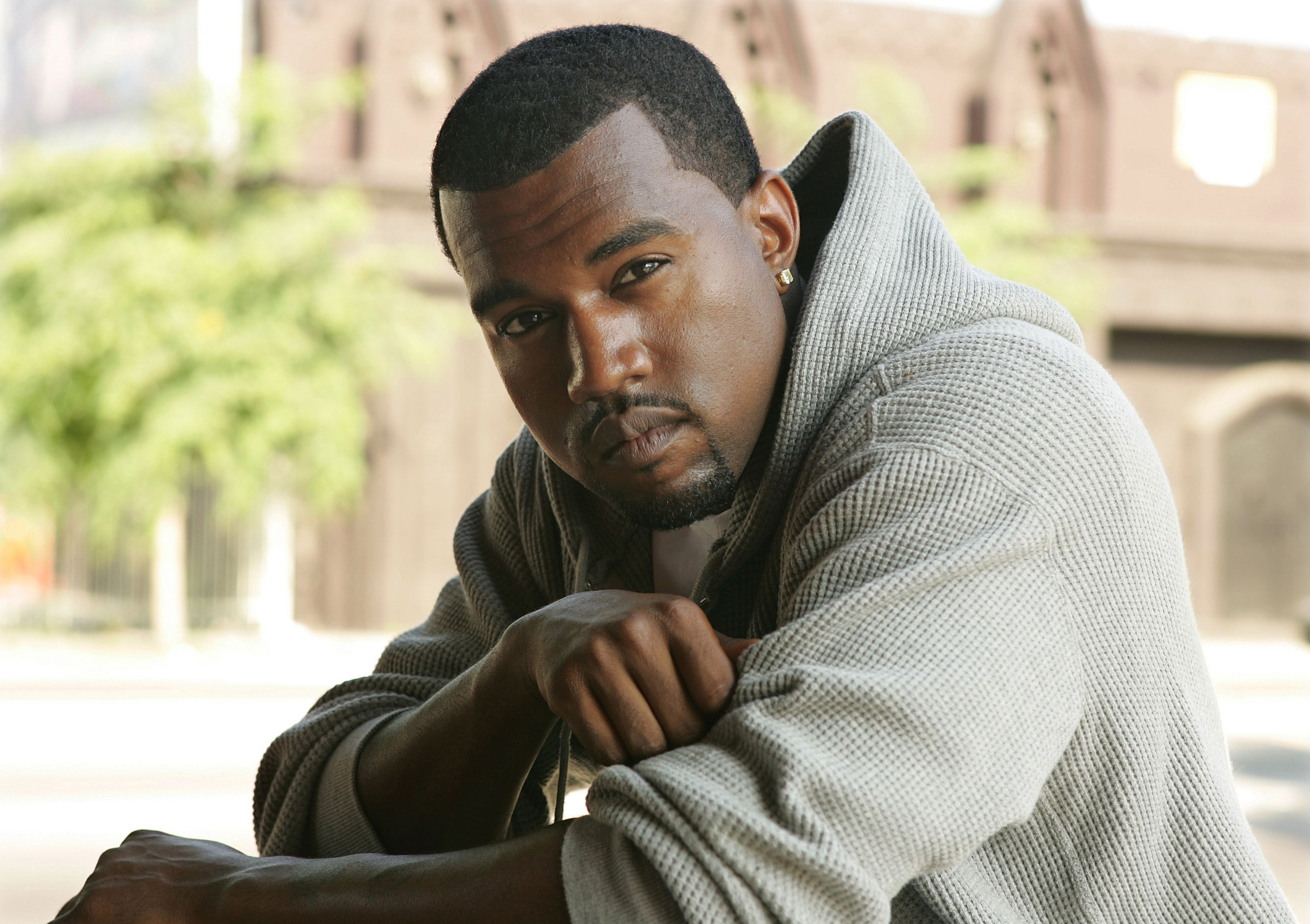 Kanye West poses for a photo outdoors, July 29, 2005 in Los Angeles, California. | Source: Getty Images