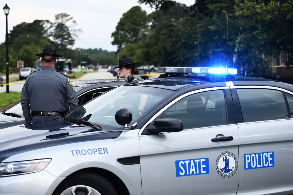 """Virginia State Troopers guards a roadblock on June 1, 2019, at the scene of the mass shooting in the Virginia Beach Municipal center in Virginia, Beach, Virginia. - A municipal employee sprayed gunfire """"indiscriminately"""" in the government building complex on May 31, 2019 