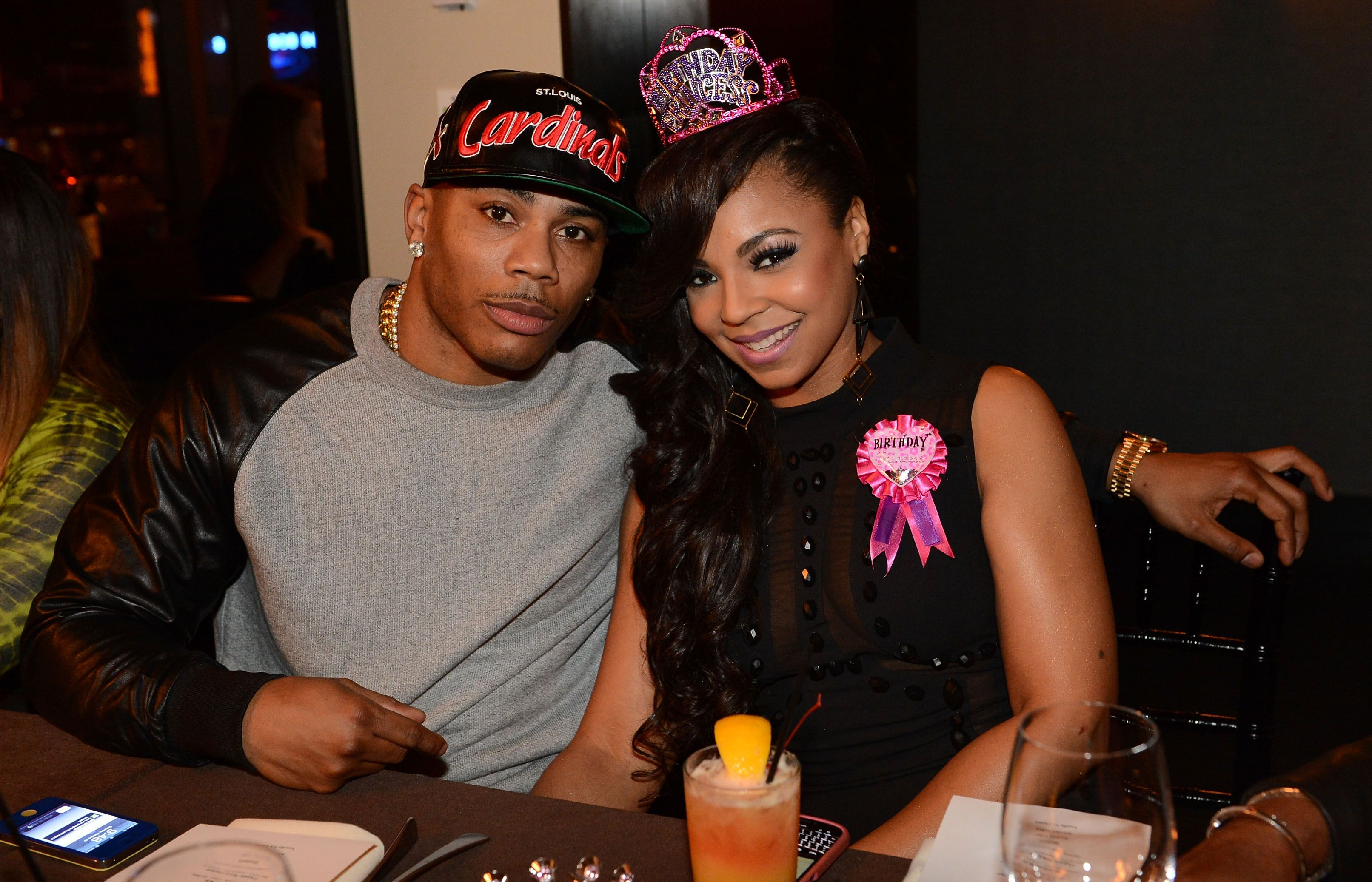 Nelly and Ashanti during Ashanti's surprise birthday dinner in October 2012 in Atlanta, Georgia | Source: Getty Images